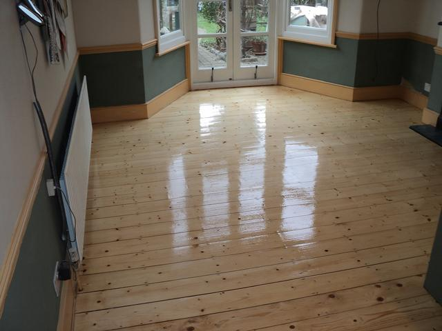Pine flooring after resanding and refinishing with 3 coats of Junckers HP Commercial lacquer.