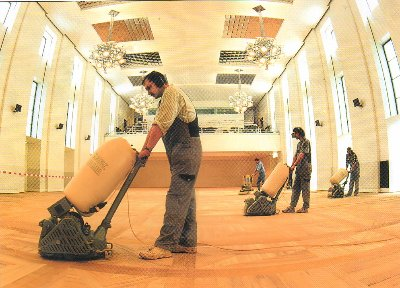 School Hall Floor Sanding in progress using endless belt sanders and trios.