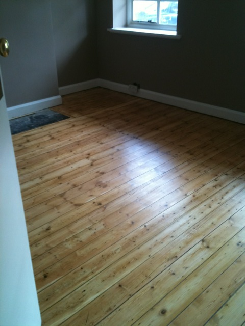 untreated softwood flooring after sanding and beautifully finished with amazing 3 coats of high traffic varnish