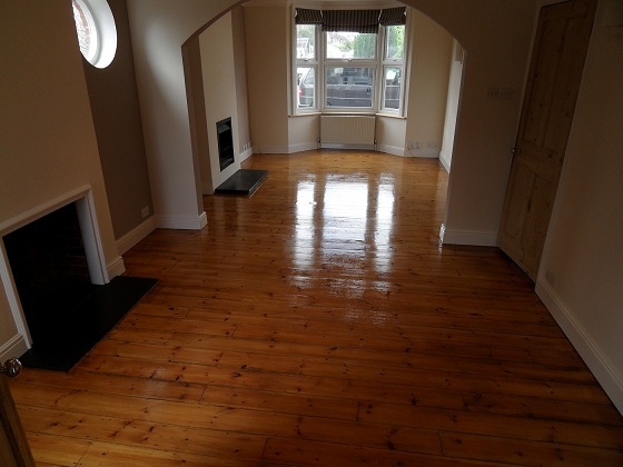 Pine floor restoration with finish of stain and clear lacquer
