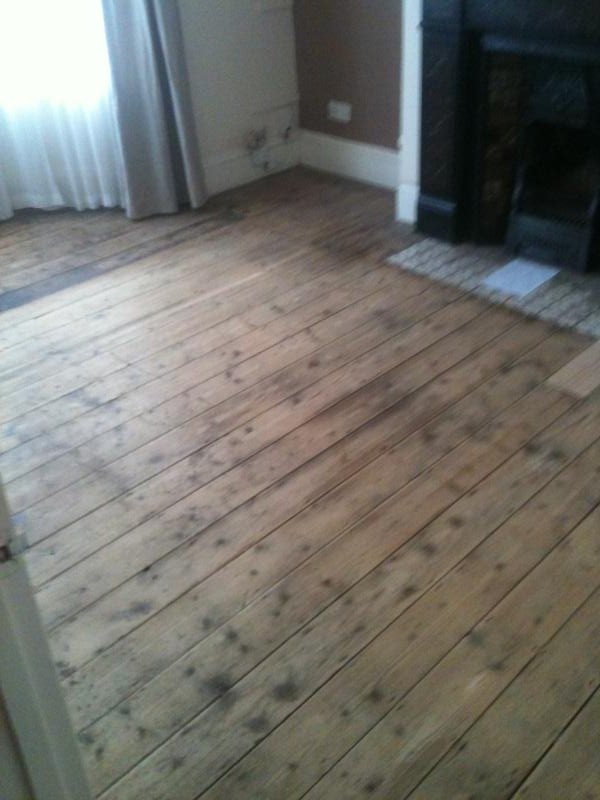 Original 1930 house with pine floor boards before sanding and finishing