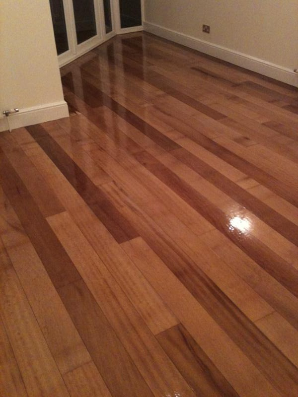 Solid hardwood floor after sanding and sealing with 3 coats of Bona Mega lacquer
