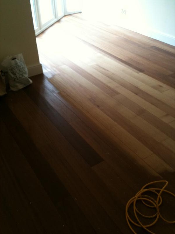 Solid hardwood floor before sanding