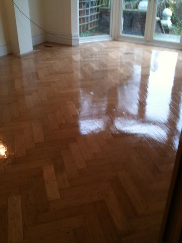 Original parquet floor after sanding, buffing and recoating with 3 layers of clear satin lacquer