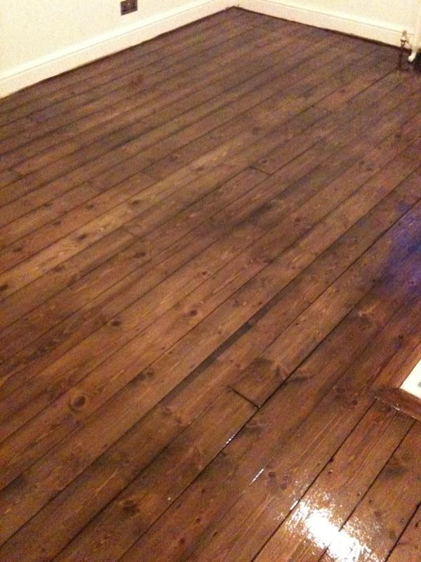 Pine floorboards after floor sanding, staining with dark brown pirit based stain plus 3 coats of clear varnish
