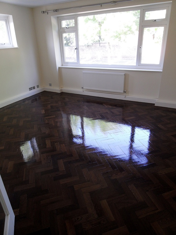 Amazing parquet floor restored to its former glory.
