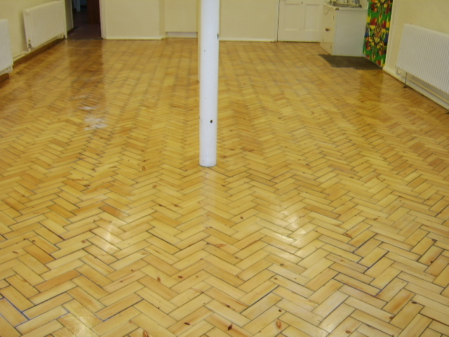 Ewelme Primary School parquet flooring after sanding, gap filling and finishing with coat of prelak and 2 coats of clear HP Commercial lacquer