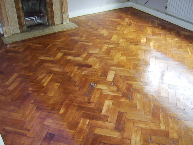 Parquet floor after restoration, sanding staining with walnut colour and 3 coats of clear satin varnish