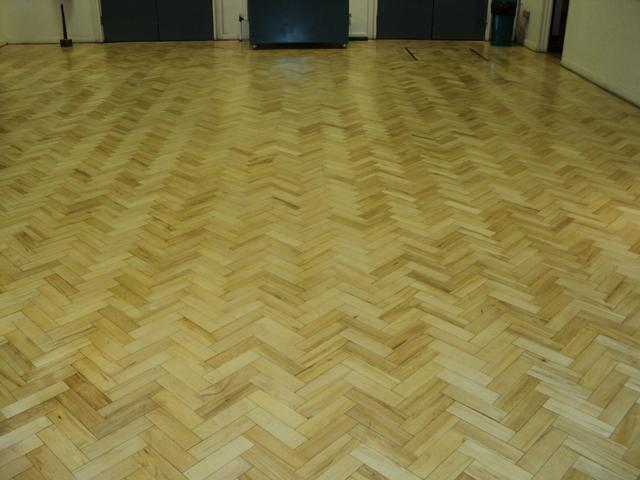 school parquet flooring after sanding and sealing with 3 coats of clear Junckers HP Commercialvarnish