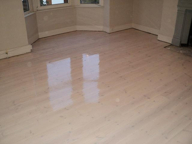 Original pine floor after sanding, minor repairs white stain and 3 coats of clear lacquer