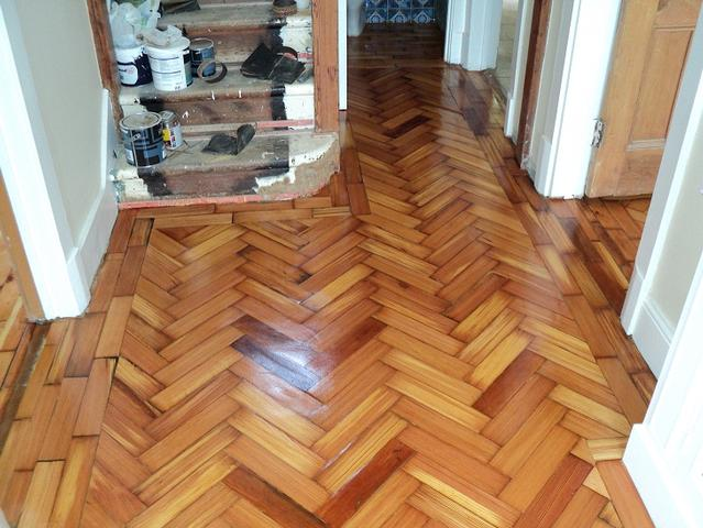 Reclaimed pine parquet blocks after gluing down, sanding, gap filling woth resin and 3 coats of Osmo hardwax oil.
