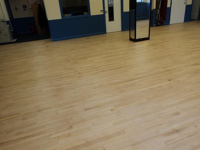 Community hall hardwood floor after sanding, buffing and sealing with 3 coats of high traffic varnish.