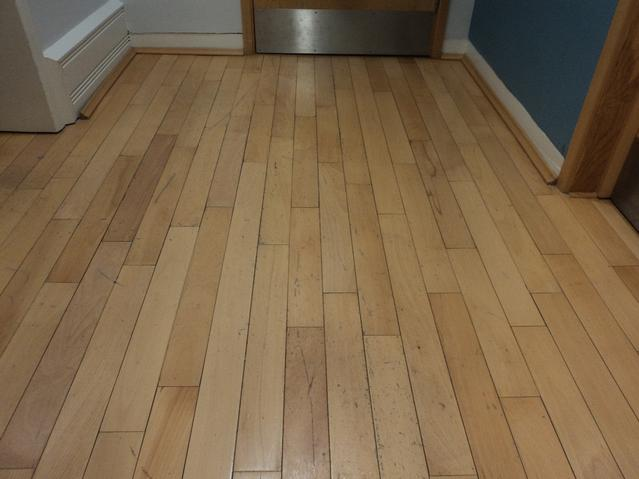 Commercial offices hardwood floor before renovation