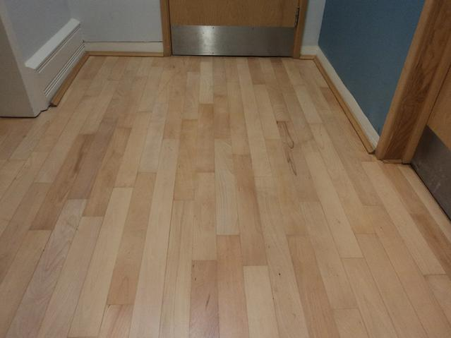 Commercial offices hardwood floor after sanding, buffing and 3 coats of clear 2 pack satin varnish