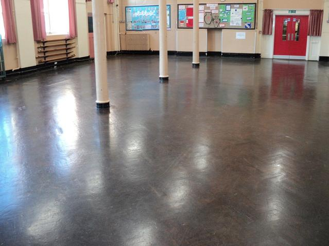 Amazingly bad school wooden floor before repairing, sanding and recoating.