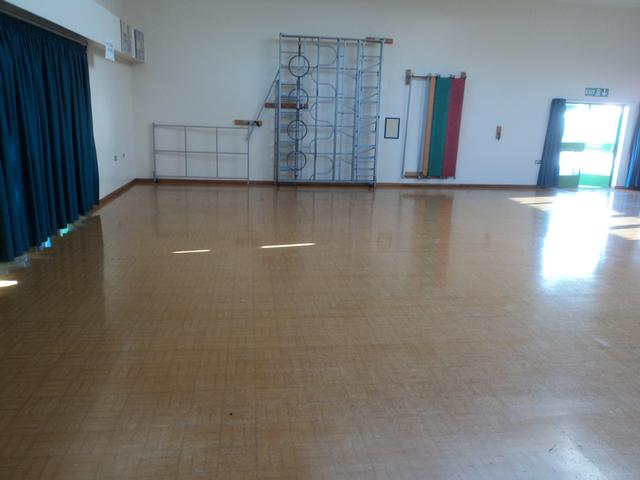 Badly scratched and damaged school granwood flooring before sanding