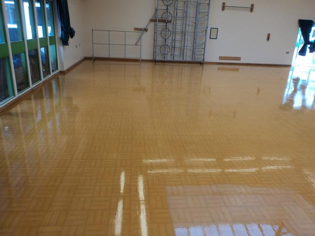 Lovely restored school sport hall Granwood block floor after sanding and refinishing with 3 coats of gloss Granguard seal.