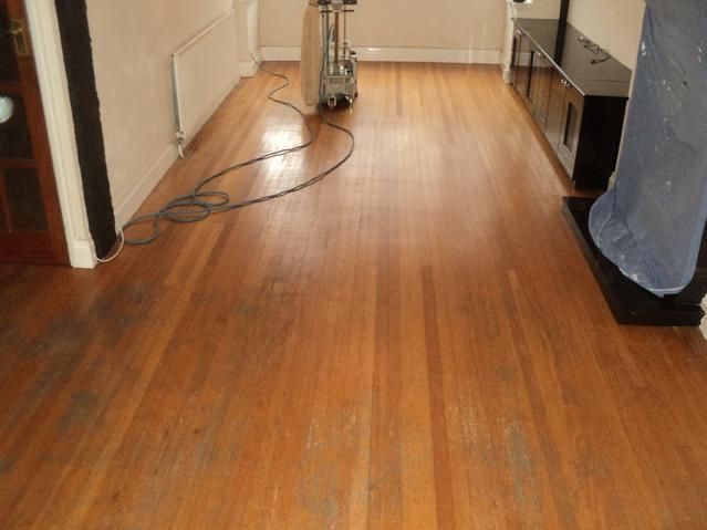Badly scaffed strip flooring prior to resand and refinish.