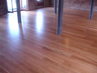 Wood floor restoration shows great transforming results in Tooting SW1.