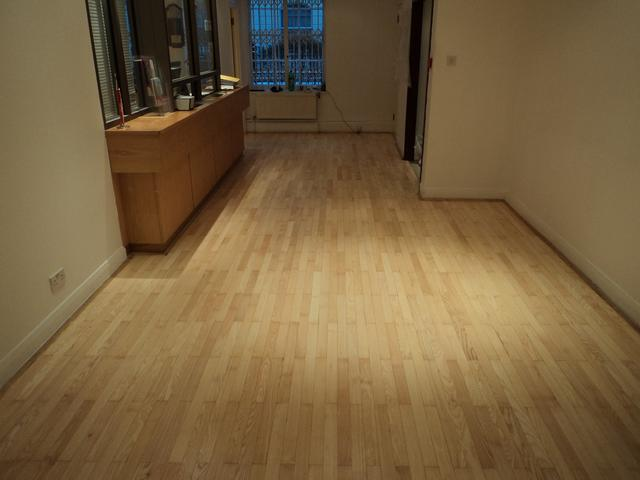 Embassy of Republic of Croatia strip hardwood floor after sanding, buffing and recoating with 3 layers of clear satin high traffic lacquer