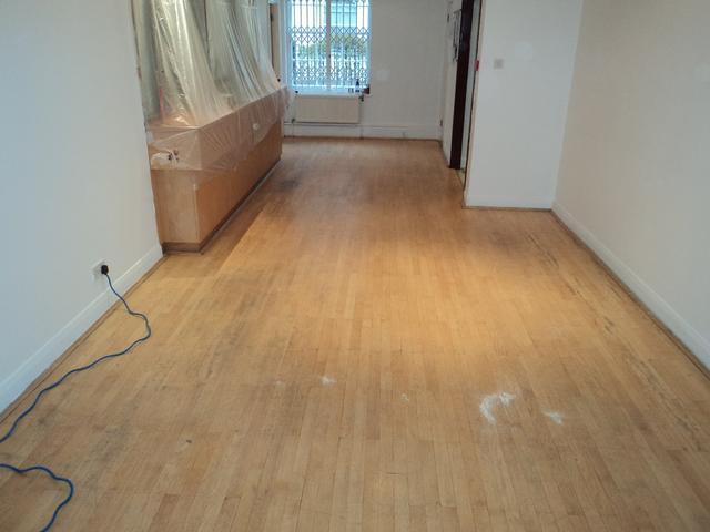 Embassy of Republic of Croatia strip hardwood floor before sanding