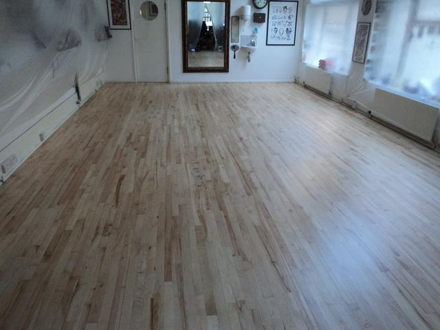 Good Times Tatoo hardwood flooring after sanding and beautifully finished with amazing 3 coats of high traffic lacquer