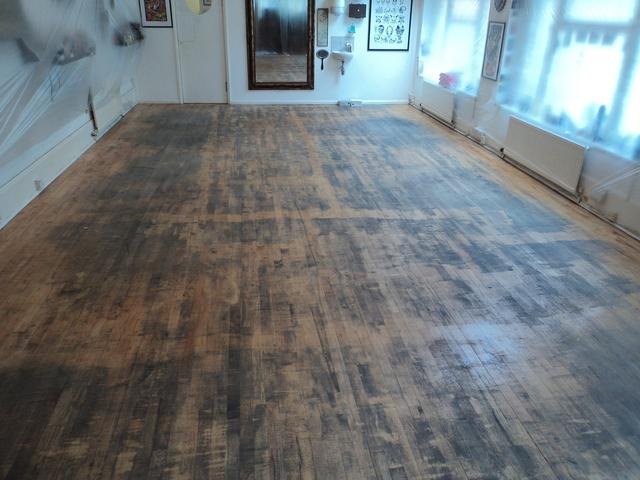 Good Times Tatoo hardwood floor before sanding