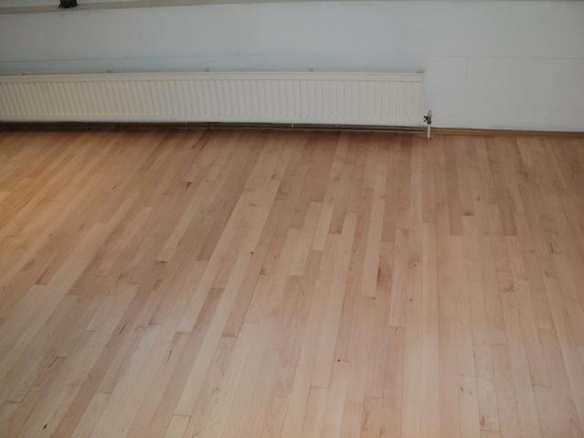 Office hardwood floor after sanding and sealing with commercial heavy duty finish.