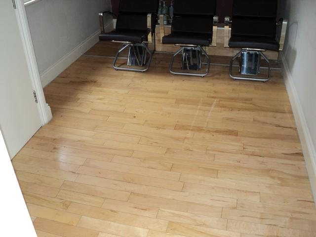 Hairdressing shop hardwood flooring before refinishing
