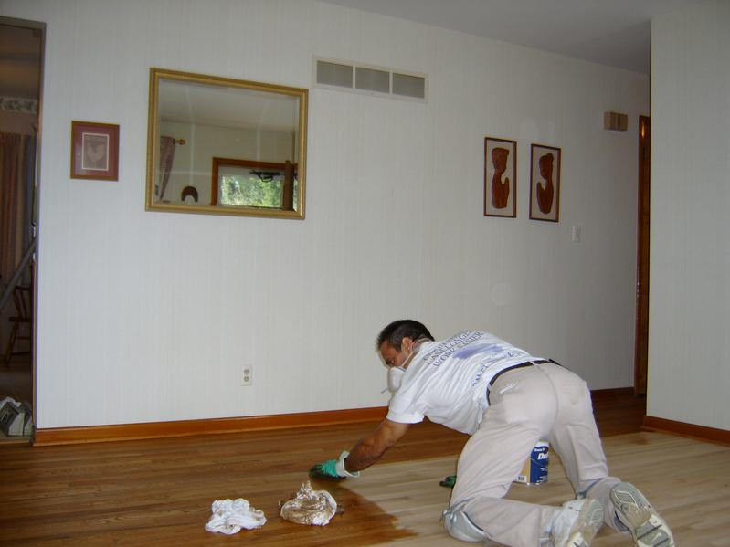 Wood Floor Repairs using staining in order to achieve perfect blend.