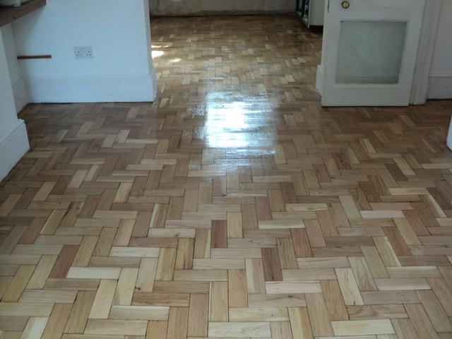 Parquet oak flooring after sanding, gap filling and varnishing with 3 coats of clear satin seal