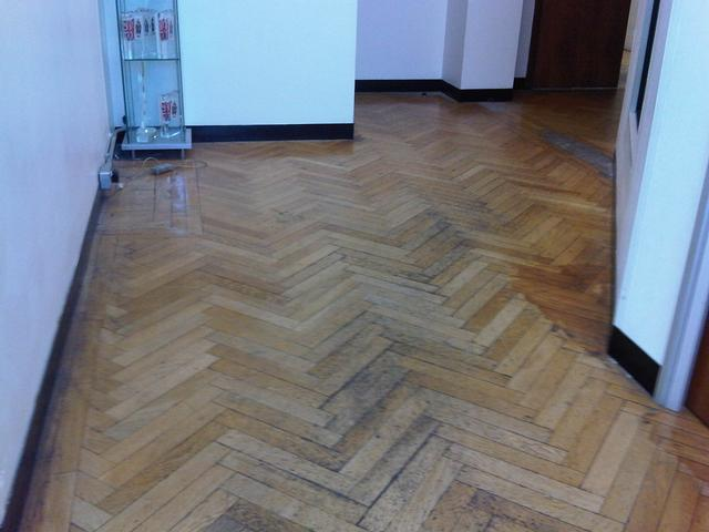 Herringbone oak floor before sanding and sealing